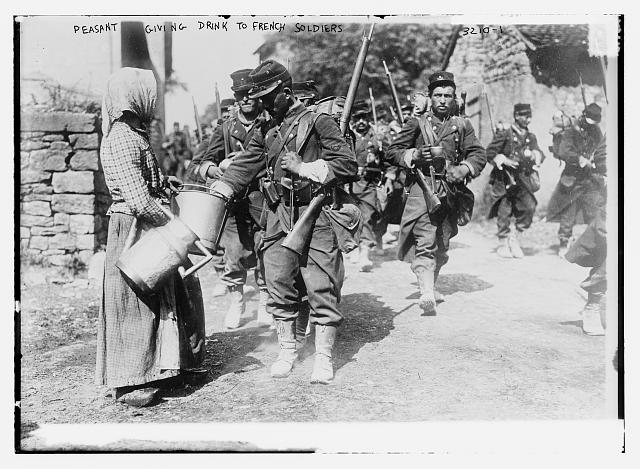 A French peasant girl offers drink to French Soldiers in 1914.  One hundred years earlier, Felicite would not have looked much different.  Photo public domain.